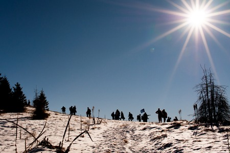 A Silhouette group of people on the top of the mountain