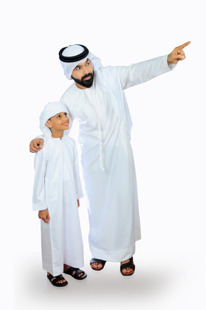 arab father and son wearing emirati traditional dress