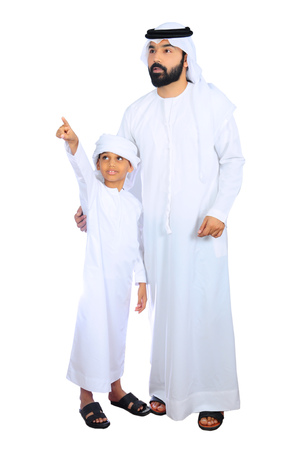 arab father and son wearing uae traditional dress ( going for shopping )