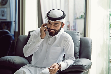 Arab Positive Man Talking In Phone ( Smartphone Technology Happy )
