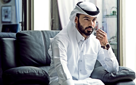 Arab BusinessMan Wearing Qatari Traditional Dress ( Arab Confident Businessman Vision ) Stock Photo