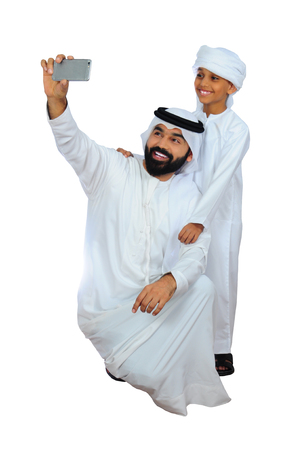 Arab Father And Son Taking Selfie ( Technology Smartphone )