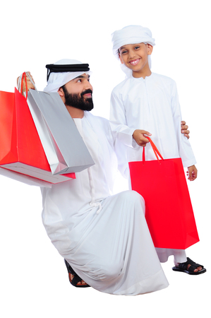 Arab Father And Son Shopping Stock Photo