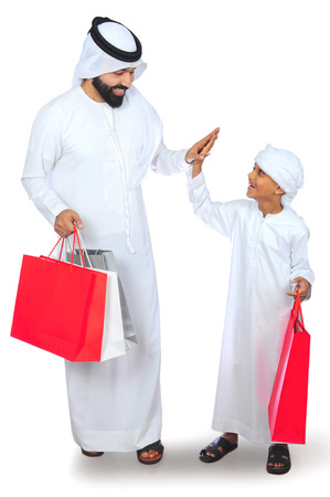Arab Father And Son ( Shopping ) Stock Photo