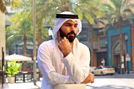 Arab Man Standing Near Palm Trees Stock Photo