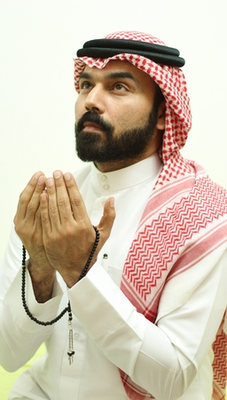 A Muslim Arab Male Model Praying And Looking In The Sky