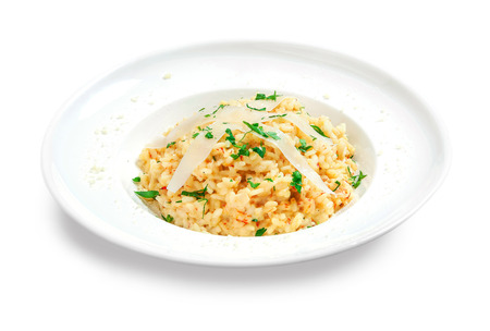 rice vegetarian with spicy creamy sauce and noodles on top in a plate on white background Stock Photo