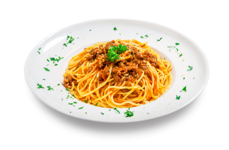 spaghetti with minced meat and sauce (bolognese) on a plate on white background