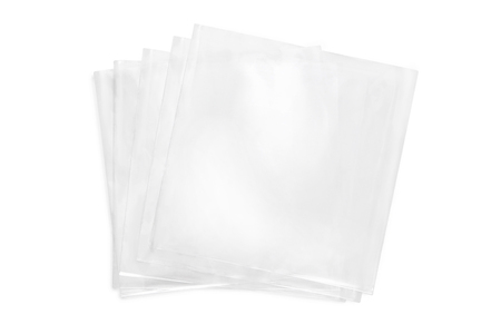 Few cellophane bags for candy. White bags package template on isolated background.