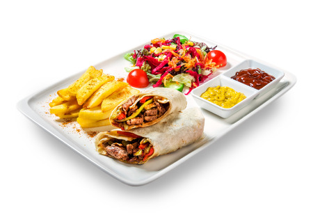 sandwiches (rolls with meat) with fries, vegetables and sauce in plate on white background
