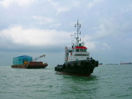 tonnage: tug boat and barge in open sea Stock Photo