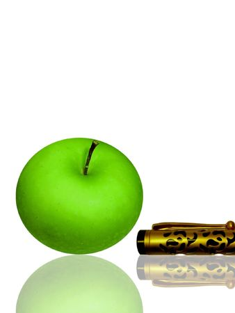 juicy apple and golden pen on white photo