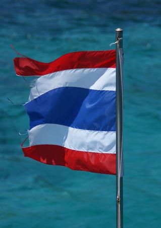 thai flag: Thai flag with multi color sea watwer background Stock Photo