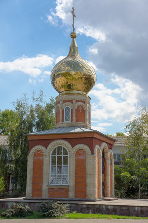 briks: red and white briks orthodox chapel whith golden dome