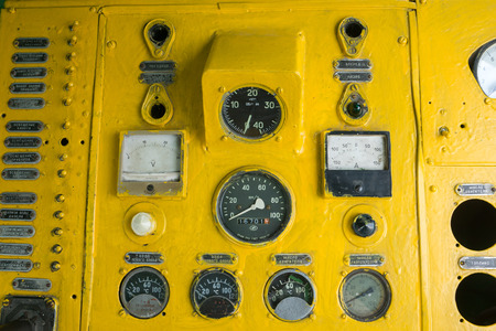 switches: yellow huge analog gauges and switches panel of old locomotive