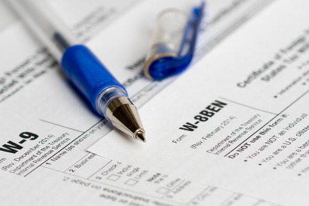 tax reporting two forms with opened blue pen Stock Photo