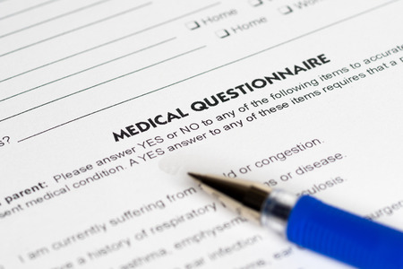health answers: medical questions with opened blue pen