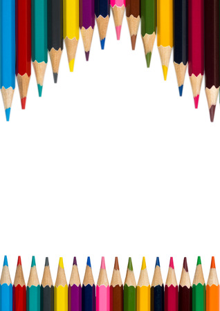 vertical frame with multicolored pencils on white background