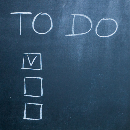 personal decisions: to do list with checkboxes on black chalkboard
