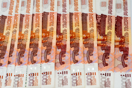roubles: lot of five thousand roubles banknotes background