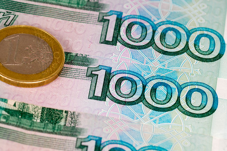 roubles: 1000 russian roubles and 1 euro coin