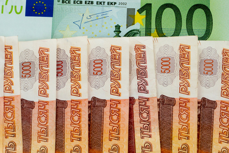 one hundred euro banknote: 100 euro and 5000 russian roubles banknotes Stock Photo