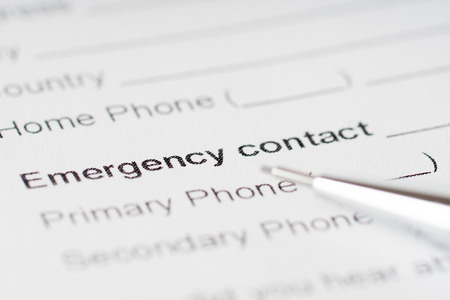 phone number: emergency contact paper sheet with phone number Stock Photo