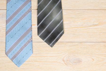 symbolics: neckties on rustic wooden desk background
