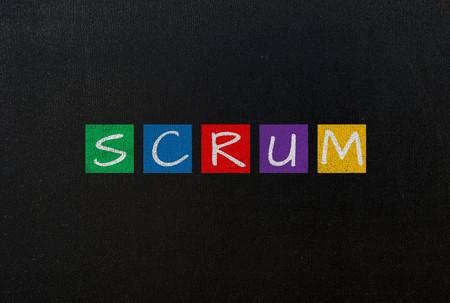 scrum: scrum on black chalk board concept