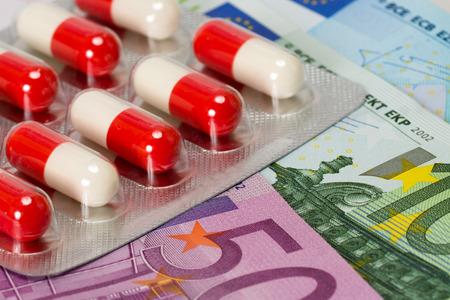 antibiotic capsules and euro banknotes