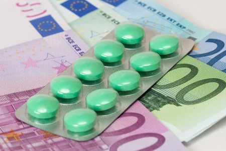antidepressant pills and euro banknotes