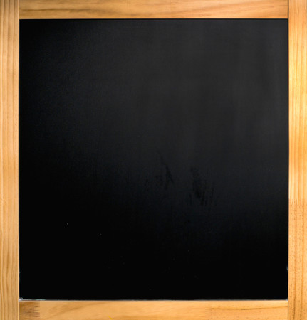empty black chalkboard with wooden frame