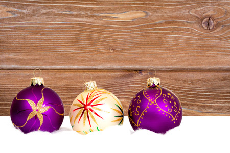 new year baubles on wooden background