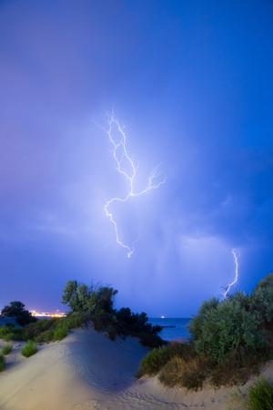 lightning bolt in night sky under sea
