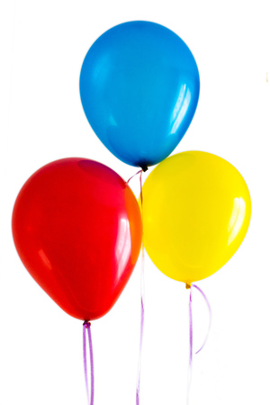 blue red yellow bright balloons isolated on white