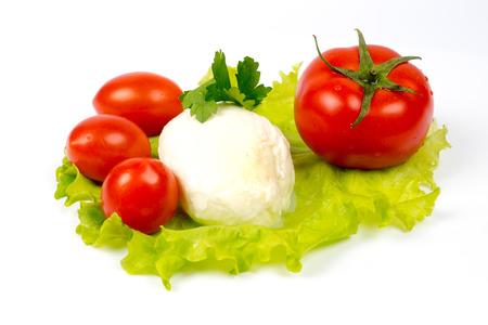 mozzarella and tomatoes on salad leaf