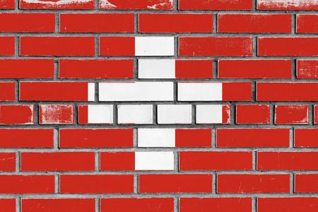 flag of switzerland painted on bricks wall Zdjęcie Seryjne