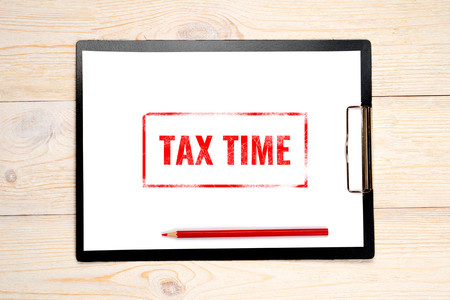 tax time red stamp on empty paper
