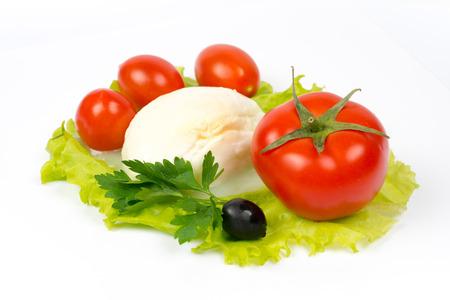 mozzarella, tomatoes and olive on salad leaf Zdjęcie Seryjne