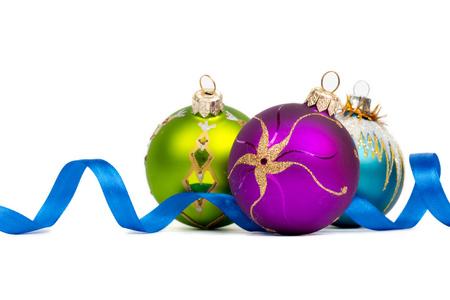 blue green purple new year balls on white background