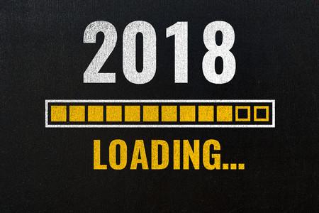 2018 loading with progress bar, chalk drawing on blackboard Foto de archivo