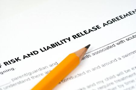 risk and liability release agreement with pencil Imagens