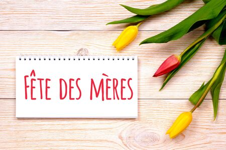 fete des meres - french mother's day, greetings on rustic planks with tulips