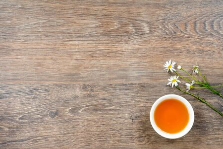 cup of organic camomile tea, healthy lifestyle concept