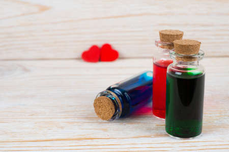 three colored love elixir on wooden table Stock Photo