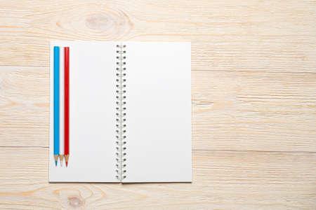 empty notebook opened on white office table Standard-Bild