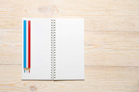 empty notebook opened on white office table