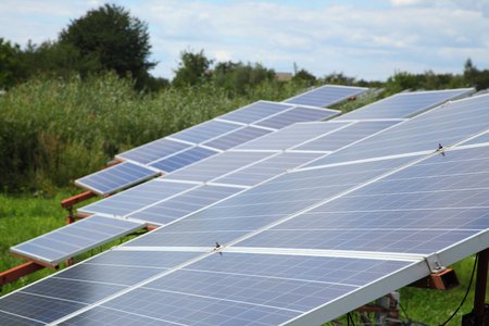 gleams: Sunlight gleams off solar panels in field - Stock Footage Stock Photo