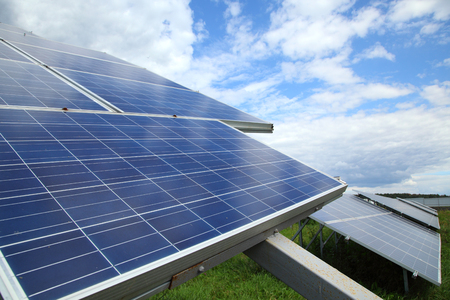 gleams: Solar panel produces green, environmentally friendly energy from the sun. Sunlight gleams off solar panel Stock Photo