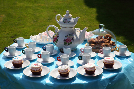 A festive table for children with cakes and sweets for tea and coffee. Table with cakes and sweets for tea.